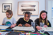 Pupils from Charlton Manor Primary School (with Above and below by John Maine)- one of 10 sustainable legacy projects to receive funding from Captain Planet Foundation as part of It's Our World - It's Our World Auction in support of The Big Draw and Jupiter Artland Foundation, Chrisites, London, UK - Over 40 leading artists including David Hockney, Sir Antony Gormley, David Nash, Sir Peter Blake, Yinka Shonibare, Sir Quentin Blake, Emily Young and Maggi Hambling have committed artworks to the be sold at on 10 March 2016. The Auction is the culmination of a mass participation environmental arts project, promoting sustainability for future generations through art. Money raised will support The Big Draw, an arts education charity that works across the UK to promote visual