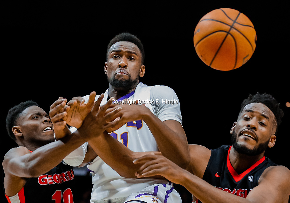 Jan 16, 2018; Baton Rouge, LA, USA; Georgia Bulldogs guard Teshaun Hightower (10) and forward Yante Maten (1) battle for a rebound with LSU Tigers forward Aaron Epps (21) during the second half at the Pete Maravich Assembly Center. Georgia defeated LSU 61-60. Mandatory Credit: Derick E. Hingle-USA TODAY Sports