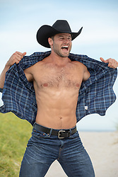 cowboy opening up his shirt and yelling