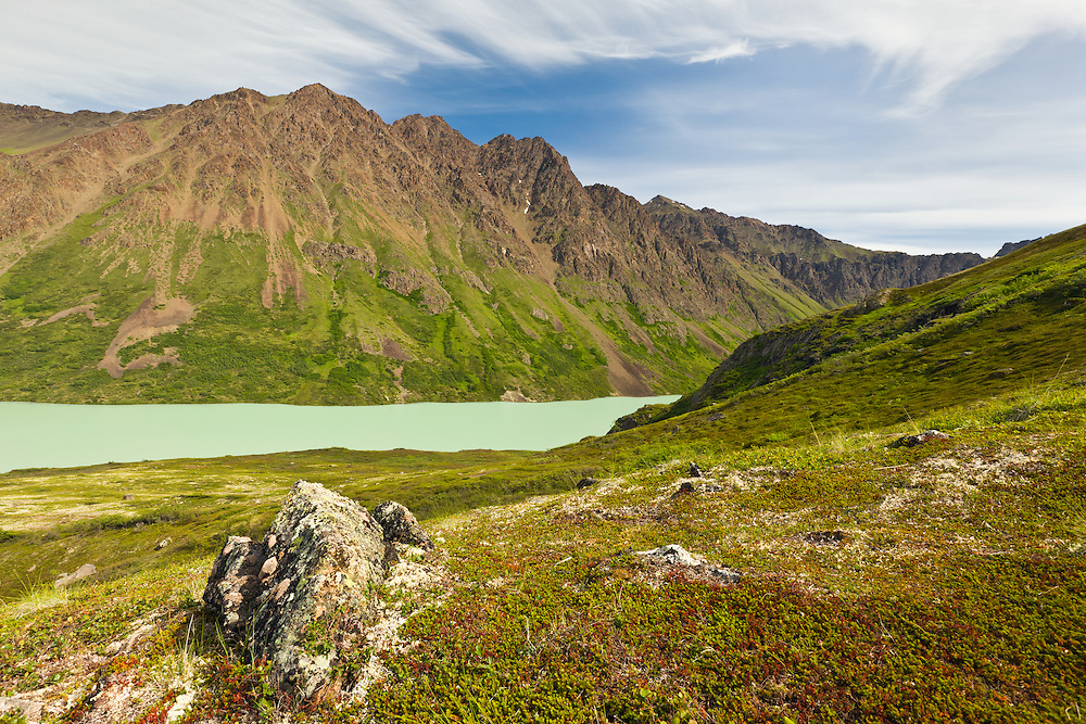 Hurdygurdy Mountain and Eagle Lake from the alpine slopes of Cantata Peak in South Fork Eagle River Valley in Chugach State Park in Southcentral Alaska.  Summer. Afternoon.