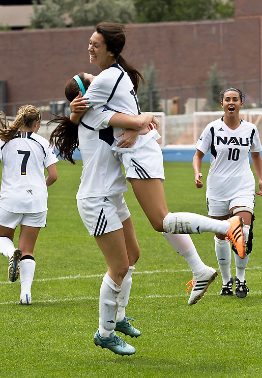 After scoring an unassisted goal, forwarder Haley Wingender (Sr.) embraces Sophomore  Adrian Nixt during the NAU women's soccer game on Sept. 6, 2015. Wingender's goal would put NAU on the board during the second half. Photo by David Carballido-Jeans.