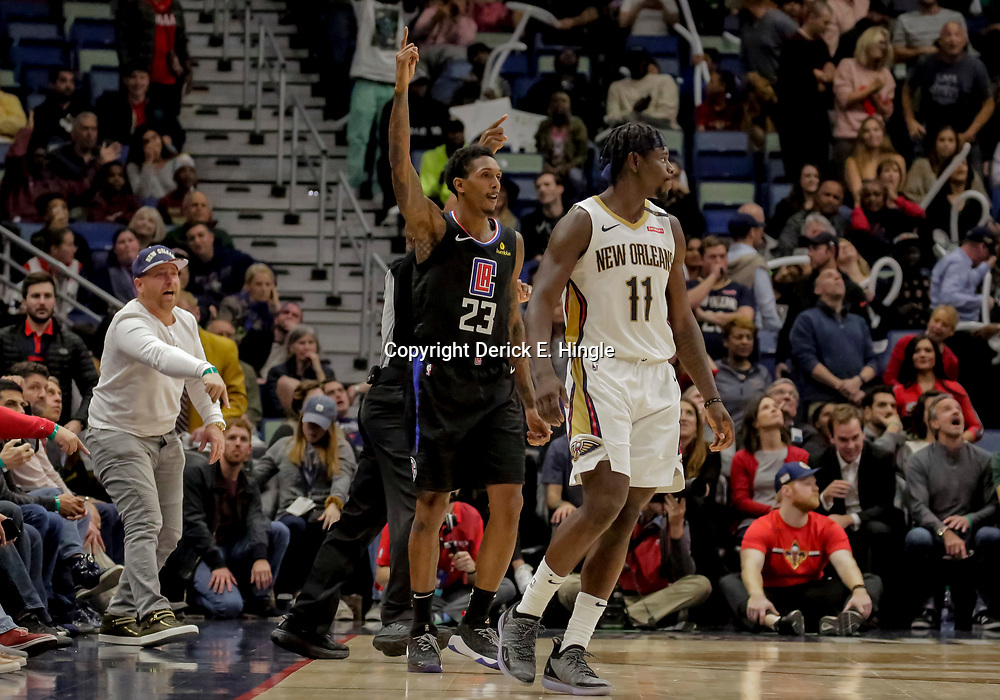 Dec 3, 2018; New Orleans, LA, USA; LA Clippers guard Lou Williams (23) reacts after hitting a basket New Orleans Pelicans guard Jrue Holiday (11) during the second half at the Smoothie King Center. Mandatory Credit: Derick E. Hingle-USA TODAY Sports