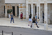 Kids playing in the street. Photographed in Acre, Galilee, Israel