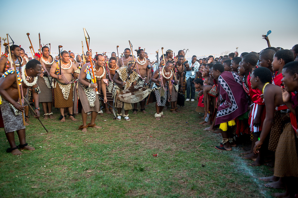 Ludzidzini, Swaziland, Africa - Annual Umhlanga, or reed dance ceremony, in which up to 100,000 young Swazi women gather to celebrate their virginity and honor the queen mother during the 8 day long event.<br /> King Mswati III , Africa's last absolute monarch, reviews the dancing maidens .  He often selects a new wife from among the girls at the event.