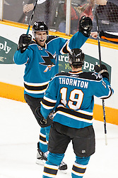 November 30, 2010; San Jose, CA, USA;  San Jose Sharks right wing Dany Heatley (15) celebrates with center Joe Thornton (19) after scoring a goal against the Detroit Red Wings during the first period at HP Pavilion. Mandatory Credit: Jason O. Watson / US PRESSWIRE