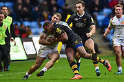 Wasps centre Gaby Lovobalavu  tackles the Chiefs winger into touch during the Aviva Premiership match between Wasps and Exeter Chiefs at the Ricoh Arena, Coventry, England on 18 February 2018. Picture by Dennis Goodwin.