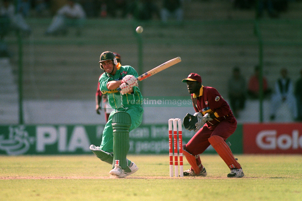 South Africa's Hansie Cronje (left) plays the shot that led to his dismissal for 40
