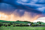 Supercell at sunset over the rolling hills of Ashton Idaho.