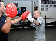 Picture by Alan Stanford/Focus Images Ltd +44 7915 056117<br /> 30/09/2013<br />  Kevin Mitchell performs in a media workout with trainer  Tony Sims at Gator ABC, Hainault, Essex..