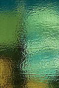 textural image: stained glass image in greenish tones