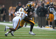 September 3, 2011: Tennessee Tech Golden Eagles cornerback Richmond Tooley (21) hits Iowa Hawkeyes wide receiver Marvin McNutt (7) after a reception during the first half of the game between the Tennessee Tech Golden Eagles and the Iowa Hawkeyes at Kinnick Stadium in Iowa City, Iowa on Saturday, September 3, 2011. Iowa defeated Tennessee Tech 34-7 in a game stopped at one point due to lightning and rain.