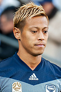 Melbourne Victory midfielder Keisuke Honda (4) walks out at the Hyundai A-League Round 2 soccer match between Melbourne Victory and Perth Glory at AAMI Park in Melbourne.