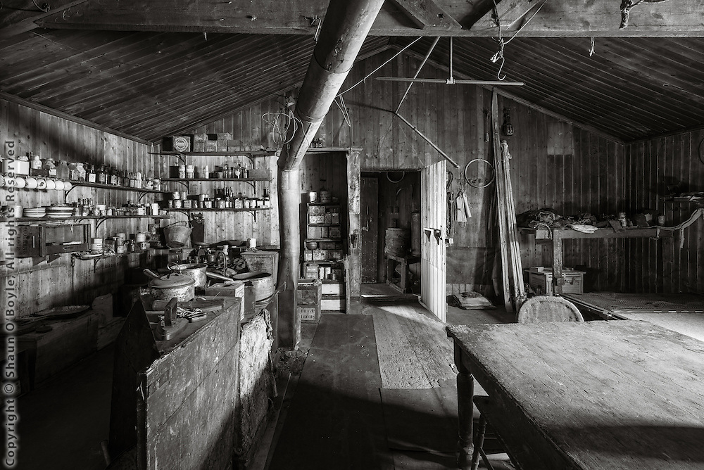 Hut entrance, mess deck table, galley on left.