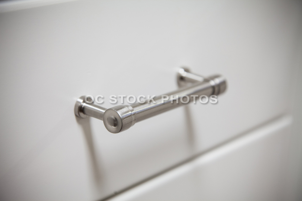 Satin Nickel Finish Drawer Pull on White Cabinets