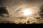 © Licensed to London News Pictures. 07/02/2017. Richmond, UK People walk under scattered cloud in Richmond Park today 7th February 2017. Photo credit : Stephen Simpson/LNP