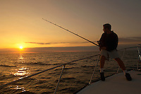 Sport Fisherman Watching Sun