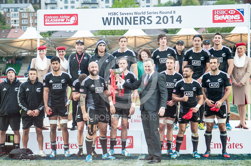 New Zealand are presented with the trophy for winning the IRB Emirates Airline Glasgow 7s at Scotstoun in Glasgow. 4 May 2014. (c) Paul J Roberts / Sportpix.org.uk