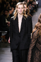 Julia Nobis walks the runway wearing Jason Wu Fall 2016, Hair by Paul Hanlon for Morocconoil, Makeup by Yadim for Maybelline, shot by Thomas Concordia during New York Fashion Week on February 12, 2016