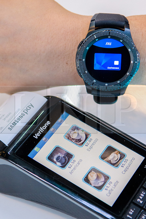 © Licensed to London News Pictures.<br /> 27/06/2017<br /> A demonstration of Samsung Pay Gear being used to make a payment using a Samsung Gear (watch) at The Money 20/20 Europe exhibition held at The Bella Centre in Copenhagen, Denmark,  June 27th 2017<br /> The Money 20/20 Europe exhibition is the largest FinTech event in Europe and show cases new and emerging technologies in the financial sector<br /> Photo credit should read Ant Upton/LNP