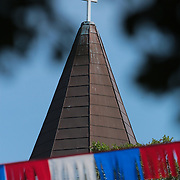 Red, white, and blue banners fly during the North Carolina 4th of July Festival Parade Friday July 4, 2014 in Southport, N.C.