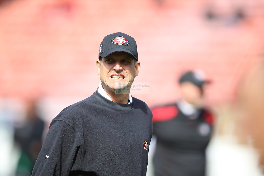 San Francisco, CA - August 20 :   Head coach Jim Harbaugh of the San Francisco 49ers looks on against the Oakland Raiders on August 2011, 2011 in San Francisco, California.   (Photo by Jed Jacobsohn)