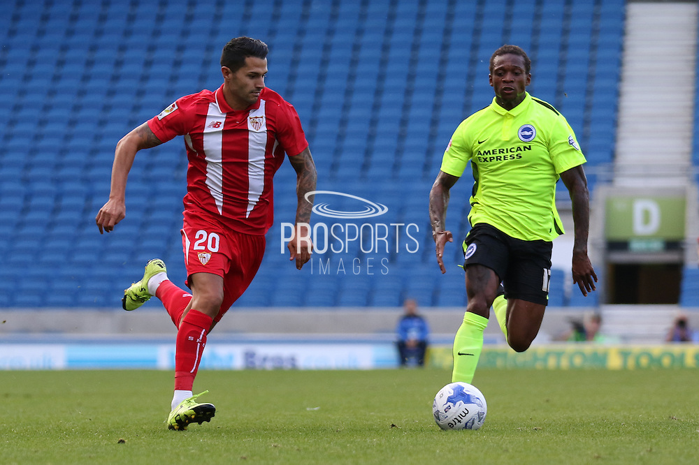 Vitolo of Sevilla and Gaetan Bong of Brighton & Hove Albion during the Pre-Season Friendly match between Brighton and Hove Albion and Sevilla at the American Express Community Stadium, Brighton and Hove, England on 2 August 2015. Photo by Ellie Hoad.