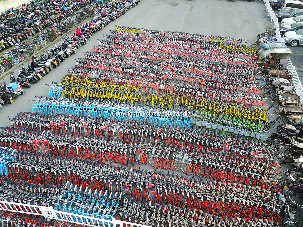 SHANGHAI, CHINA - FEBRUARY 28: <br /> <br /> Over 4,000 Shared Bicycles Confiscated In Shanghai<br /> <br /> Aerial view of confiscated shared bicycles at a parking lot of Huangpu District on February 28, 2017 in Shanghai, China. The vehicle management company of Huangpu District confiscated about 4,000 shared bicycles as random parking of the ride-share bikes has been an inconvenience, including over 3,500 Mobikes. Ride-share bicycles parked randomly across Shanghai have been causing problems for pedestrians and public transportation. <br /> &copy;Exclusivepix Media