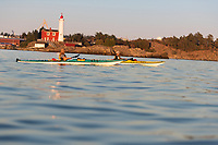 Kayaking at sunset by Fort Rodd Lighthouse in Victoria, BC