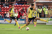 York City midfielder Anthony Straker ball sets up York City forward Vadaine Oliver for his goal  during the Sky Bet League 2 match between York City and Dagenham and Redbridge at Bootham Crescent, York, England on 20 October 2015. Photo by Simon Davies.