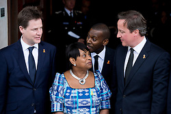 © London News Pictures. 22/04/2013. London, UK.  L to R - NICK CLEGG, DOREEN LAWRENCE, STUART LAWRENCE and DAVID CAMERON  pose for photographers outside St Martins in the Field Church in London following a memorial service to mark the 20 anniversary of the murder of Stephen Lawrence. Stephen Lawrence was murdered in a racist attack while waiting for a bus in SOuth London on the evening of 22 April 1993. Photo credit : Ben Cawthra/LNP