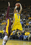 February 10 2011: Iowa Hawkeyes forward Kalli Hansen (3) puts up a shot as Minnesota Golden Gophers forward Jackie Voigt (45) defends during the first half of an NCAA women's college basketball game at Carver-Hawkeye Arena in Iowa City, Iowa on February 10, 2011. Iowa defeated Minnesota 64-62.