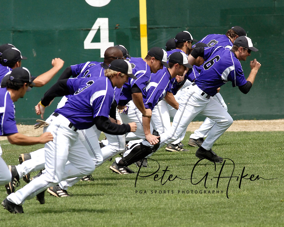 The Kansas State Wildcats run some pre-game sprints before their game with Oklahoma State.  Oklahoma State defeated K-State 9-4 in 10 innings at Tointon Stadium in Manhattan, Kansas, April 30, 2006.