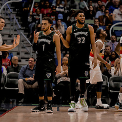 Dec 31, 2018; New Orleans, LA, USA; Minnesota Timberwolves guard Tyus Jones (1) and center Karl-Anthony Towns (32) react to an officials call during the second half against the New Orleans Pelicans at the Smoothie King Center. Mandatory Credit: Derick E. Hingle-USA TODAY Sports