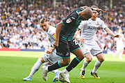 Leeds United defender Ezgjan Alioski (10) tackles Swansea City forward Andre Ayew (22) during the EFL Sky Bet Championship match between Leeds United and Swansea City at Elland Road, Leeds, England on 31 August 2019.