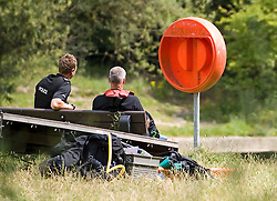 © licensed to London News Pictures. 15/07/2011. Maidenhead, UK. An empty safty buoy on the riverbank. Police divers from a search and rescue team searching Cookham Lock near Maidenhead, Berkshire today (15/07/2011) where 59 year-old Michael Payne went into the river trying to save his teenage daughter Zoe. Zoe was pulled to safety, but Mr Payne dissapeared beneath the surface , watched by his partner and two daughters. Photo credit should read Ben Cawthra/LNP