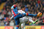 Crystal Palace defender Joel Ward  beats Liverpool midfielder Roberto Firmino (11)  to the ball during the Barclays Premier League match between Crystal Palace and Liverpool at Selhurst Park, London, England on 6 March 2016. Photo by Simon Davies.