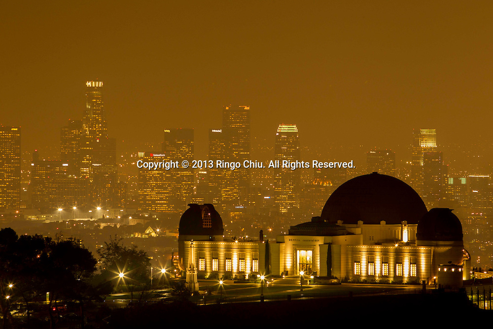 A view of Griffith Observatory and downtown Los Angeles, California, during a heavy fogy day on Wednesday, October. 23, 2013. (Photo by Ringo Chiu/PHOTOFORMULA.com)