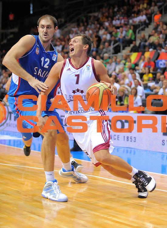 DESCRIZIONE : Siauliai Lithuania Lituania Eurobasket Men 2011 Preliminary Round Lettonia Serbia<br /> GIOCATORE : Janis Blums<br /> CATEGORIA : palleggio<br /> SQUADRA : Lettonia Serbia<br /> EVENTO : Eurobasket Men 2011<br /> GARA : Lettonia Serbia<br /> DATA : 01/09/2011 <br /> SPORT : Pallacanestro <br /> AUTORE : Agenzia Ciamillo-Castoria/T.Wiedensohler<br /> Galleria : Eurobasket Men 2011 <br /> Fotonotizia : Siauliai Lithuania Lituania Eurobasket Men 2011 Preliminary Round Lettonia Serbia<br /> Predefinita :