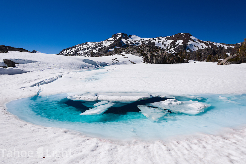 Desolation wilderness backcountry winter trip. Frozen lakes, glacial blue water and snow