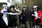 During the festival of Purim a scuffle breaks out between the Neturei Karta and Zionist Jews as they try to burn the Israeli flag in Stamford Hill, London. The Neturiei Karta oppose Zionism and believe that Jews are forbidden to have their own state until the coming of the Messiah.