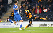 Hull City midfielder Sone Aluko (24) stretches to control during the The FA Cup match between Hull City and Brighton and Hove Albion at the KC Stadium, Kingston upon Hull, England on 9 January 2016.