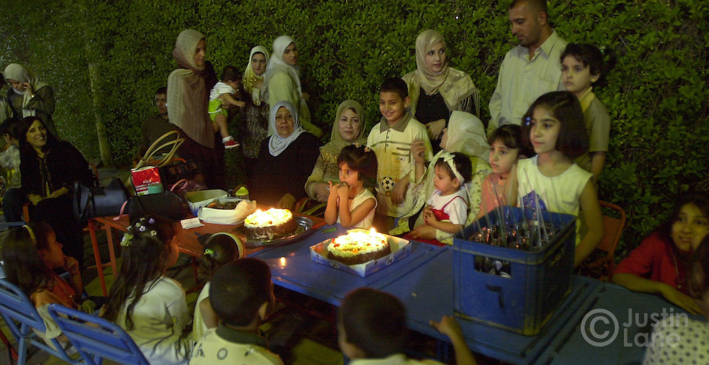 09/29--Baghdad, Iraq--Nightlife is a bit limited in Baghdad given certain cultural norms and security concerns. HERE, Zhara Ali, center in front of cake, celbrates her 7th birthday with her family at the Rayhana Cafe in Baghdad.JUSTIN LANE FOR THE NEW YORK TIMES