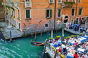 Patio dining on the Grand Canal, Venice, Veneto, Italy