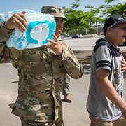 OCTOBER 20 - PONCE, PUERTO RICO - <br /> North Carolina National Guard SSG Joe Rodriguez carries water donated water and MRE's for Nani Soto in a distribution center in a sports arena in the Southern town of Ponce, the 2nd largest city in Puerto Rico. <br /> (Photo by Angel Valentin/Freelance)