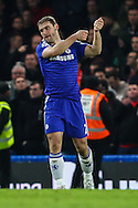 Branislav Ivanovic of Chelsea celebrates scoring the opening goal against Liverpool during the Capital One Cup Semi Final 2nd Leg match between Chelsea and Liverpool at Stamford Bridge, London, England on 27 January 2015. Photo by David Horn.