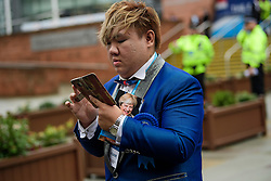 © Licensed to London News Pictures. 01/10/2017. Manchester, UK. A conference delegate seen on the opening day of the Conservative Party Conference. There have been conflicts within the conservative party and government over the UK's approach to Brexit, which is expected to feature heavily at this years event. Photo credit: Ben Cawthra/LNP