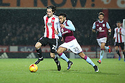 Aston Villa defender Jordan Amavi (23) battles for possesion with Brentford midfielder/ forward (Ramallo) Jota (23) during the EFL Sky Bet Championship match between Brentford and Aston Villa at Griffin Park, London, England on 31 January 2017. Photo by Matthew Redman.