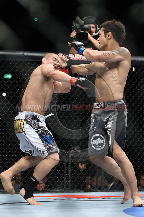 "BIRMINGHAM, ENGLAND, NOVEMBER 5, 2012: Chris Cariaso (left) is caught by a right hook from Vaughan Lee during ""UFC 138: Munoz vs. Leben"" inside the National Indoor Arena in Birmingham, United Kingdom"