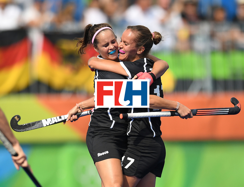 Germany's Pia-Sophie Oldhafer (L) celebrates scoring a goal with Germany's Jana Teschke during the women's field hockey New Zealand vs Germany match of the Rio 2016 Olympics Games at the Olympic Hockey Centre in Rio de Janeiro on August, 8 2016. / AFP / MANAN VATSYAYANA        (Photo credit should read MANAN VATSYAYANA/AFP/Getty Images)