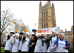 The MP's team take part in the MP's and Lords race against political Journalist in the Rehab Parliamentary Pancake Shrove Tuesday race a charity event which sees MPs and Lords joined by media types in a race to the finish. Victoria Tower Gardens, Westminster, Tuesday February 12, 2013. Photo By Andrew Parsons / i-Images